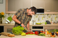 Man cutting tomatoes Royalty Free Stock Images