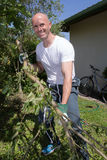 Man cutting tree branches in harden Royalty Free Stock Photo