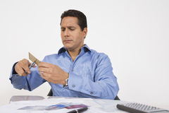 Man Cutting Up Credit Card Royalty Free Stock Photo