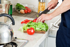Man cutting vegetables Royalty Free Stock Photos