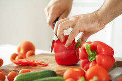 Man cutting vegetables for salad Stock Image