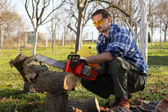 Man cutting a wood. Man cutting wood with electric saw Royalty Free Stock Photography