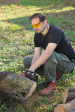 Man cutting wood. With electric saw Stock Photos