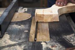Man cutting wood by circular saw blade. Close up Stock Photos