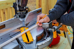 Man cutting wood on electric saw. Saws for cutting trees Stock Photo
