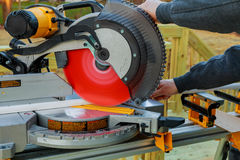Man cutting wood on electric saw. Saws for cutting trees Royalty Free Stock Photos