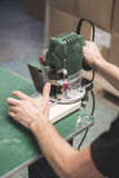 Man cutting wood with a milling machines. Closedup Royalty Free Stock Photos