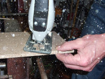 Man cutting wood with saw. Man cutting wood with a saw. Saws are a great tool to cut chipboard Royalty Free Stock Images
