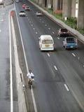 Man cycles in Bangkok Royalty Free Stock Photos