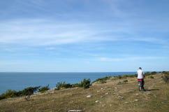 Man cycling along the coast Royalty Free Stock Image