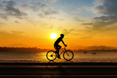 Man cycling at beach evening time Royalty Free Stock Photo