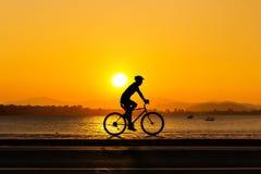 Man cycling at beach Royalty Free Stock Image
