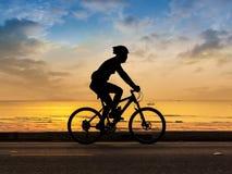 Man cycling at beach Royalty Free Stock Images