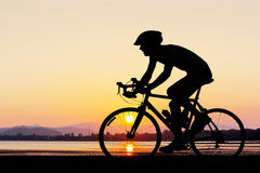 Man cycling at the beach twilight time Stock Photography