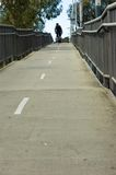 Man cycling on bridge overpass Royalty Free Stock Images