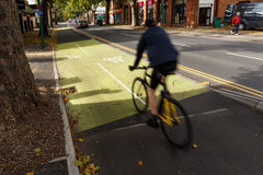 Man cycling on cycle lane in Nottingham, England. Royalty Free Stock Image
