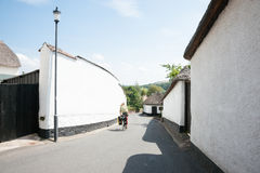 Man cycling down lane Royalty Free Stock Photo