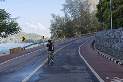 Man cycling downhill on the road. Royalty Free Stock Image