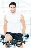 Man cycling at the gym Stock Images