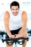 Man cycling at the gym Stock Photo