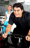 Man cycling at the gym Stock Image