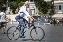 Man cycling in the historic center of Rome, Italy Royalty Free Stock Photos
