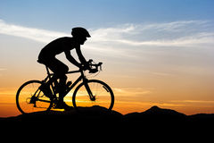Man cycling at mountain on twilight Royalty Free Stock Images