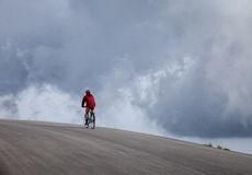 Man cycling in mountains Stock Photos