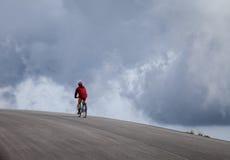 Man cycling in mountains Stock Photos