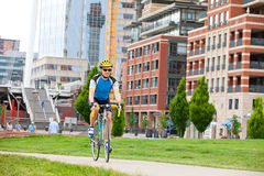 Man cycling in the park Royalty Free Stock Image