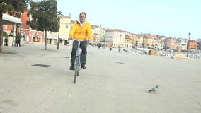 Man cycling on road in Rovinj, Croatia. stock video