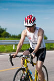 Man  cycling in triatlon Stock Images