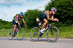Man  cycling in triatlon Stock Photo
