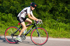 Man  cycling in triatlon Stock Photography