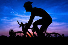 Man cycling on twilight Royalty Free Stock Image