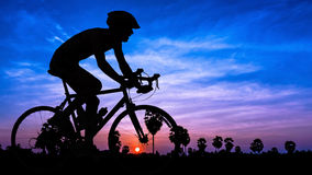 Man cycling on twilight time Royalty Free Stock Photography