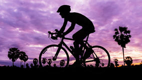 Man cycling on twilight time Royalty Free Stock Photos