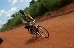 A man cycling in Uganda Stock Photo