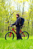 Man Cyclist with Bike and Backpack Stock Photo