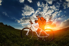 Man Cyclist with bike on sunset Royalty Free Stock Photo