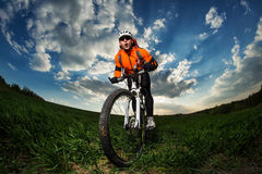 Man Cyclist with bike on sunset Royalty Free Stock Images
