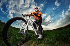 Man Cyclist with bike on sunset Stock Image