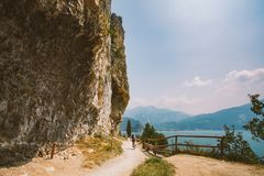 Man cyclist on a mountain bike riding on a gravel bike route at a height near the Lago di Garda in summer in Italy.  Stock Images