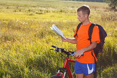 Man cyclist with read the map Stock Photo