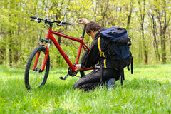 Man cyclist repairing a bike Royalty Free Stock Images
