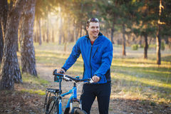 Man cyclist rides in the forest on a mountain bike. Stock Photography