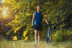 Man cyclist rides forest paths Stock Image