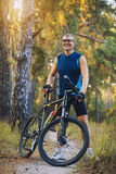 Man cyclist rides forest paths Stock Photo