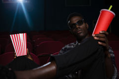 Man in 3d glasses watching movie. In theatre Royalty Free Stock Photo