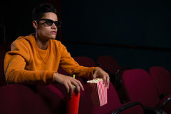 Man in 3d glasses watching movie. In theatre Royalty Free Stock Photography